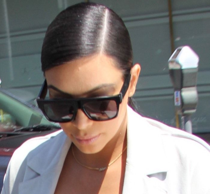 Kim Kardashian Flaunts Cleavage in Nude Pumps While Visiting Anastasia Salon