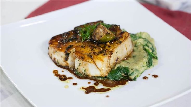 Lacquered Halibut Steak recipe from chef Marcus Samuelsson, Today Food ~ 10 oz. steak, bone in, 1 inch thick.  Ketjap Manis (sweet and tart soy sauce), evoo, garlic, fresh dill, brushed over steak cooked in hot pan, 4 min. side w/evoo, add butter and baste.  This looks delicious!