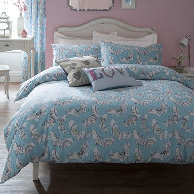 This matching bedding and curtain set utilises pastels and patterns to create a bohemian look. Don't be afraid to go for bold patterns in pastel, as the pale pastel colour tends to soften the pattern. The curved headboard is a nice touch here too.