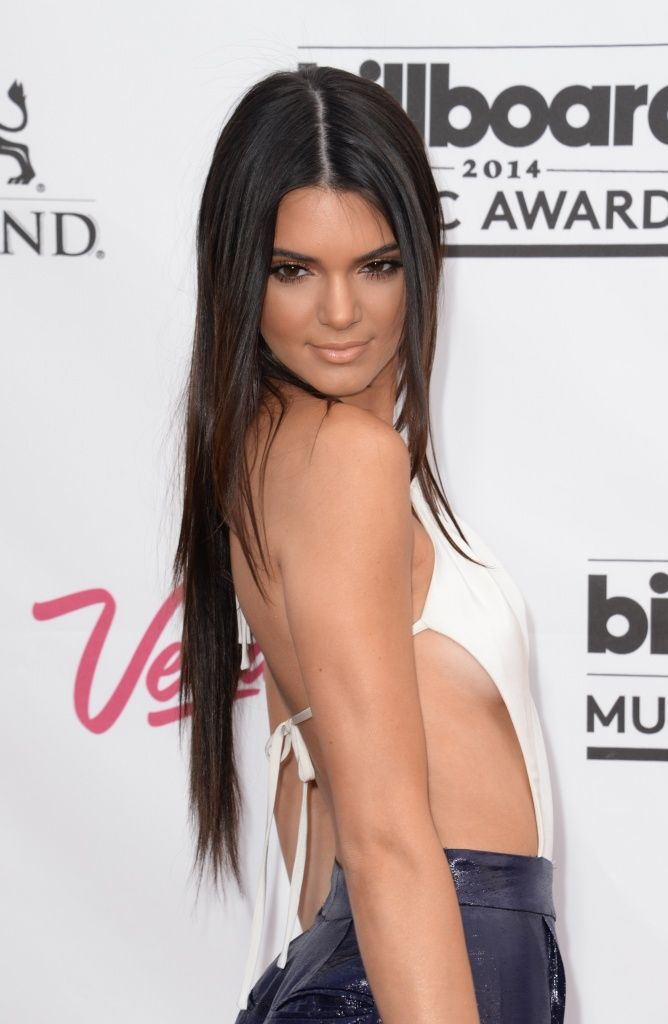Kim Kardashian's half-sister Kendall Jenner was left red-faced at the 2014 Billboard Music Awards in Las Vegas on Sunday by stumbling through her lines as she tried to introduce a performance by Australian boyband 5 Seconds of Summer.  The reality TV star and model tried to laugh off her