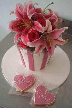 Single tier, pink and white stripe small wedding cake decorated with large pink Tiger Lillies as the wedding cake topper