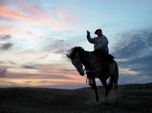 Gaucho at sunset, Necochea, Argentina