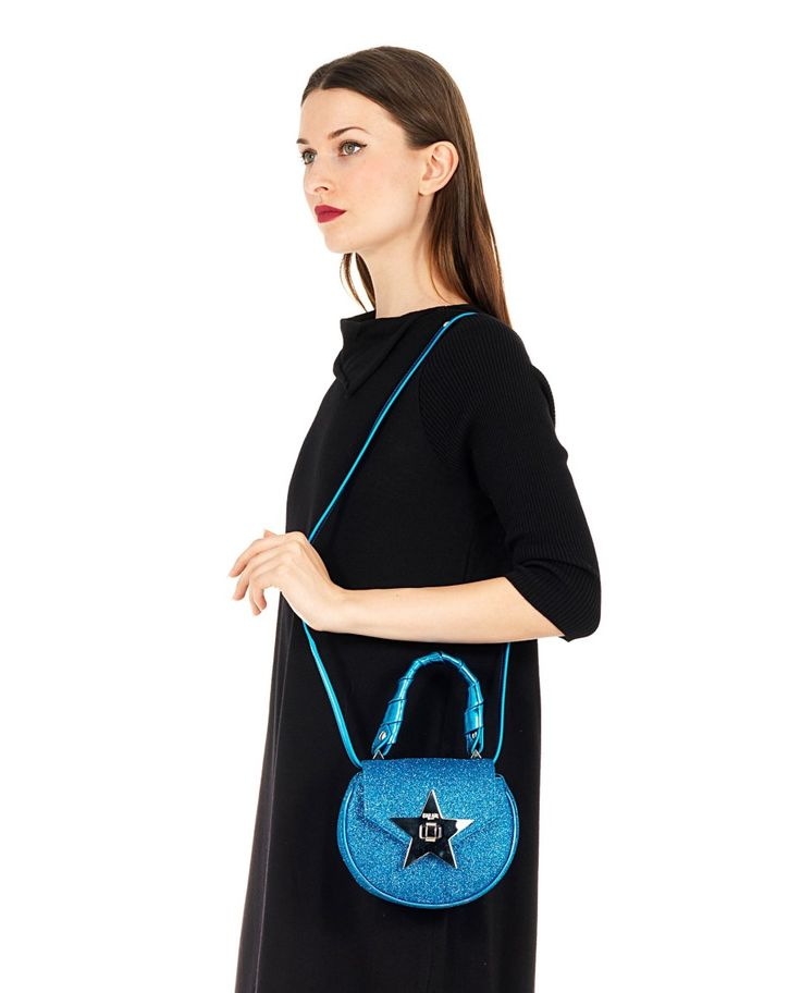 SALAR Blue glitter leather handbag  with twisted leather handle removable leather shoulder strap  star on the front flap inner lining turn lock on the front flap Size: 18x16x6 cm 100% Lambskin