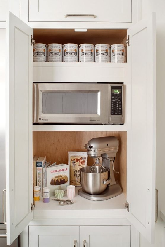pantry niche with microwave shelf at accessible level, maybe the toaster where the mixer is? and room to set a saucer, closed doors for food storage below