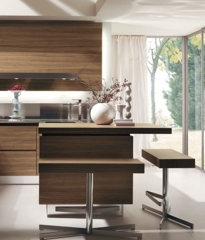 Salvarani HighTech Kitchen, n teak, canaletto walnut or ebony: refined workmanship to create prestigious finishes. Careful and versatile design offers unlimited composition possibilities. Combinations which are important, luxurious, rich in detail. www.artaccademia.com