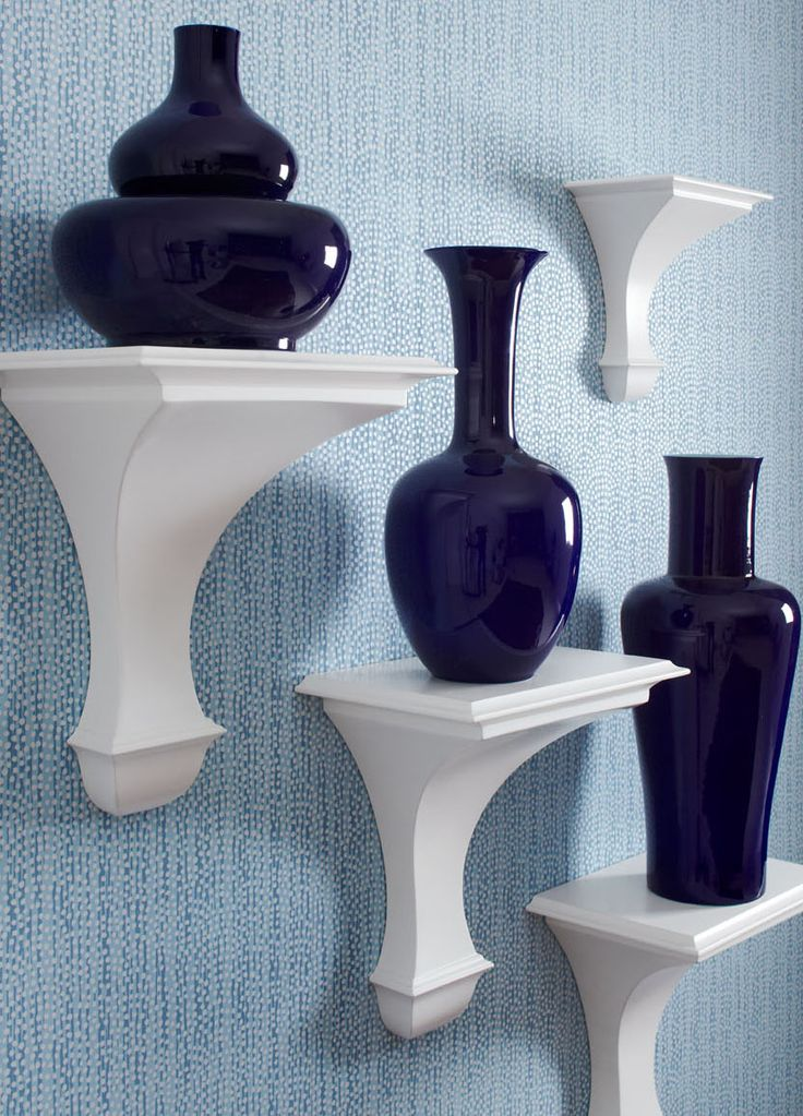 Add dimension to your wall by displaying your pretties on shelves and brackets. [Pictured: Blair Wall Brackets from Global Views]