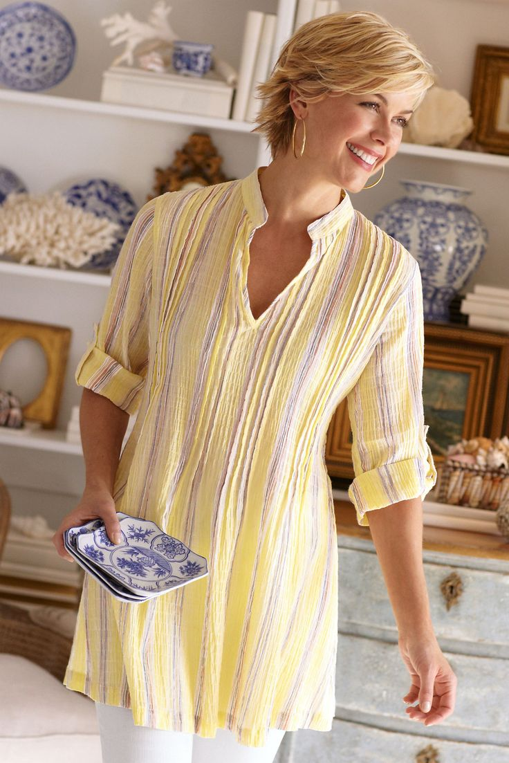 Accented with delicious summer colors, our Ibiza Gauze Tunic has a flattering neckline and roll-tab detail.