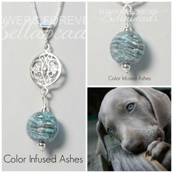 All of our pet memorial jewelry is handmade with a lock of your pet's hair, fur and or ashes. We can add flower petals for a burst of beautiful colors for your custom pet memorial jewelry for you or to give as a memorial gift in memory of a beloved pet. Description: The 12 mm handmade Bellabead in this pendant is a beautiful compliment for the sterling silver charm inspired by the wrought iron gates of Charleston, South Carolina. The pendant shown was made pet ashes and a bust of color…