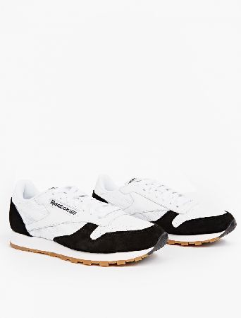 Reebok CL LEATHER SPP WHITE/BLACK-GUM The Reebok Suede Classic Sneakers, seen here in black and white. - - - - Reebok present their iconic Classic silhouette in an understated monochrome colourway for 2016. The uppers are crafted from pre http://www.MightGet.com/january-2017-13/reebok-cl-leather-spp-white-black-gum.asp