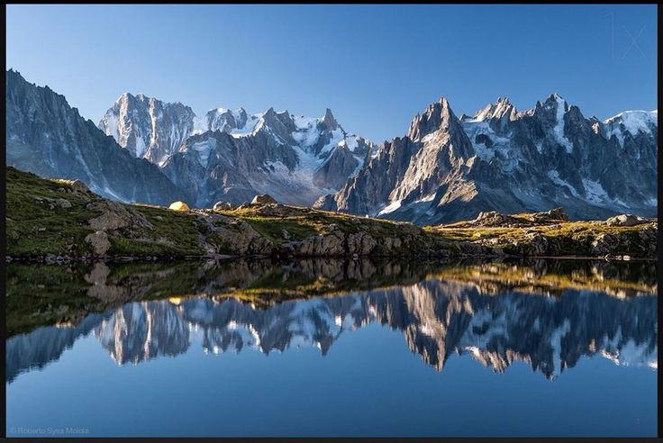 France, department Haute-Alps. Mont Blanc range reflects in the Chesery lake near Chamonix
