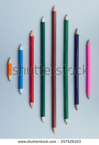 Mirror effect concept with wooden crayons over blue background