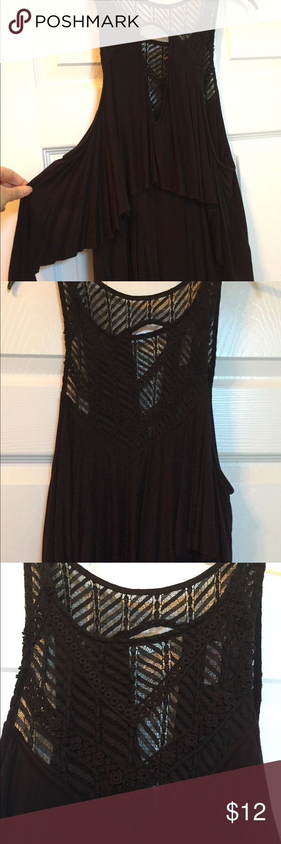 Free people crochet tank top with ruffle layers Turn heads in this free people top! Top is crochet bottom has ruffle like layers Free People Tops Tank Tops