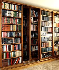 book-shelves-sliding-rolling-door-bookcase-design  I could see this for my door into the master bedroom instead of a barn door design. This serves many purposes.
