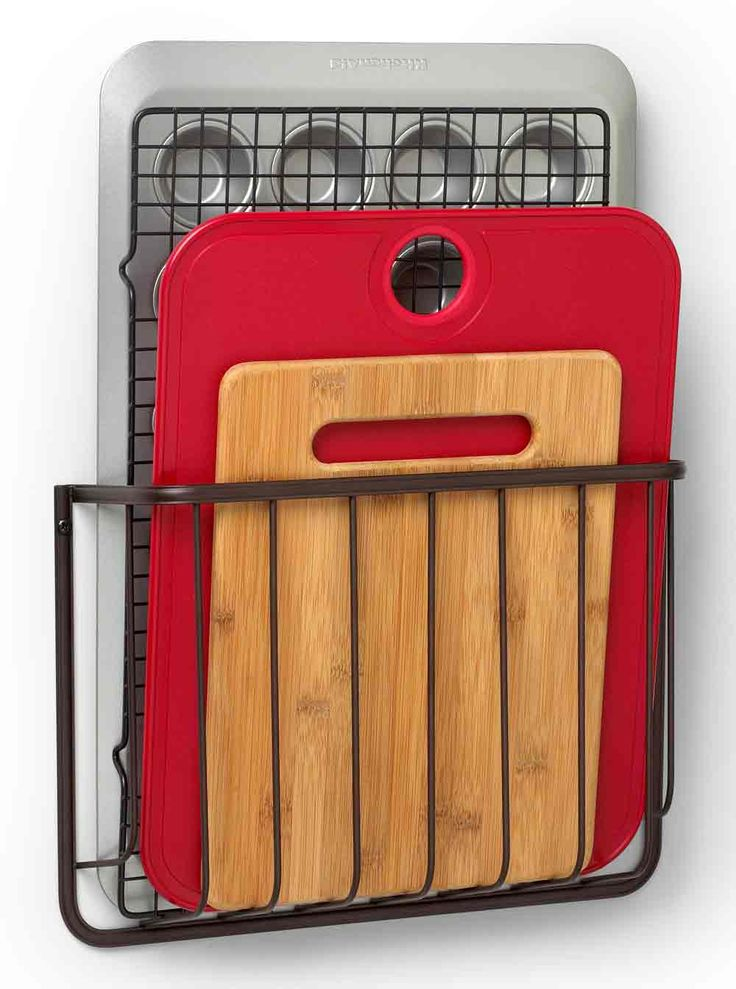 Cutting Board Holder is a screw-in rack for holding small cutting boards cookie sheets and other flat kitchenware upright in your cupboard or on a wall.