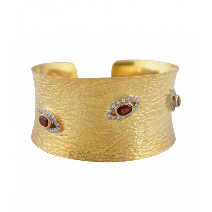 Rich Clear Eye Cuff. Be the golden goddess! The unique combination of gold-plated Sterling Silver & Cubic Zircon results in this special cuff. Its exclusive design and sheer elegance will make you stand out in a crowd. $146