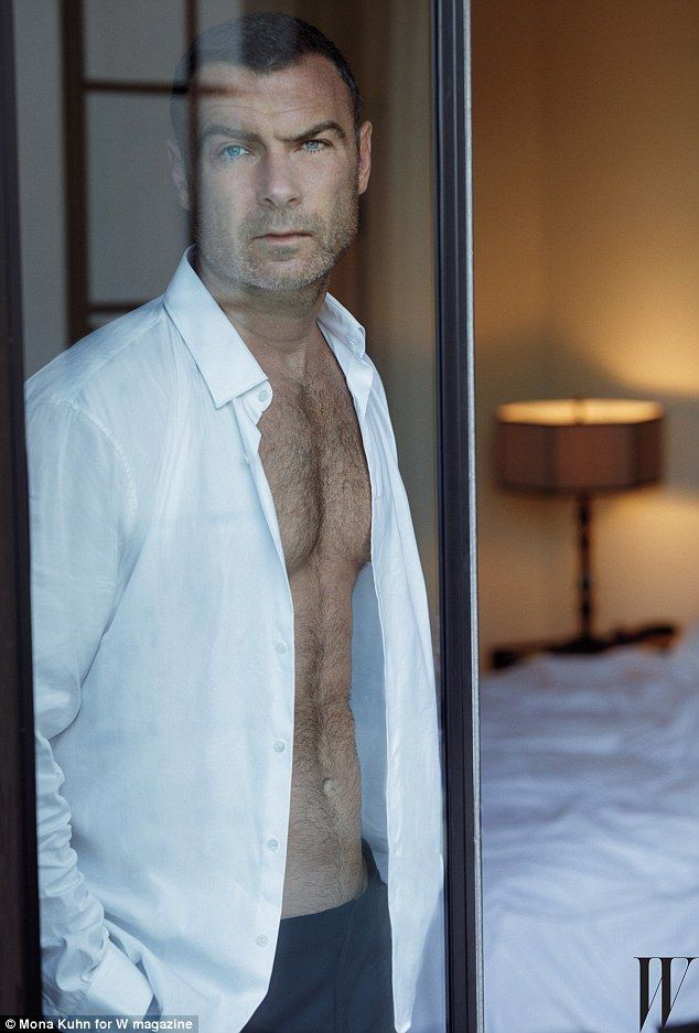 Smouldering! Liev Schreiber, 48, is also featured in the racy spread as the X-Men star looks ever the hunk in his photograph