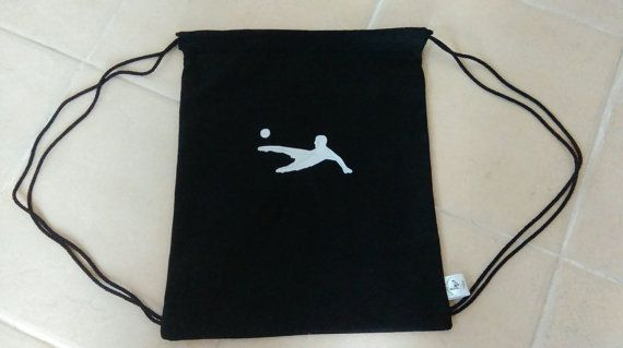 This simple gym bag will provide the perfect storage solution for all your footballers equipment. With a felt footballer detail on the front and a plain back. The canvas bag can be closed by pulling the drawstring straps on either side of the bag. The bag can be personalised with a name displayed under the football detail. The bag measures 41 cm x 36 cm when laid flat not including the straps. To request a personalised name on the bag please message when ordering otherwise the item will be…