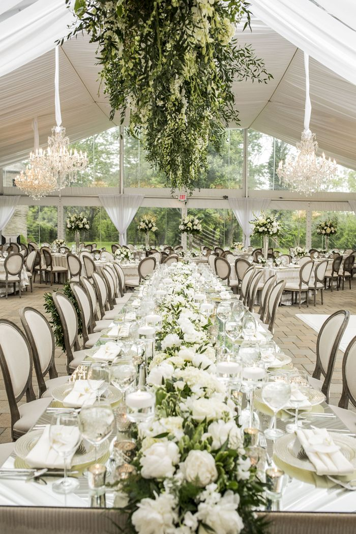 Long Mirror-Top Table, Floral Fixture Above  Photography: Annette Navarro | White Wedding | Garden Wedding | Pin curated by Emily Coyne Events