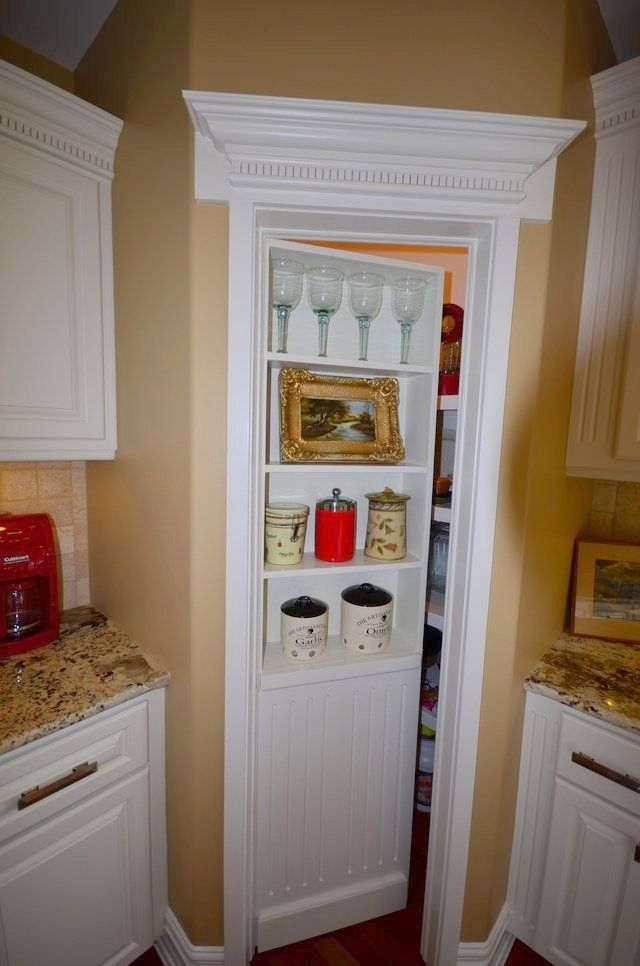 Hidden storage secret door shelf that opens up to reveal for Hidden kitchen storage ideas