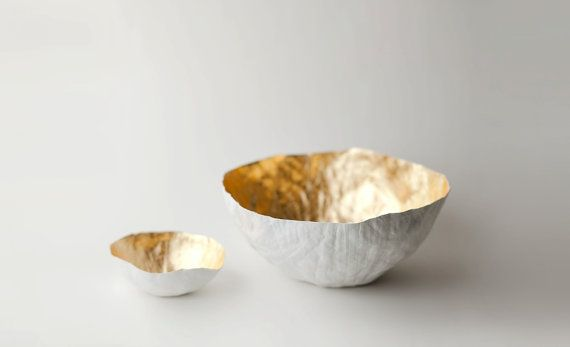 Etsy Seller, up in the air somewhere, from Chicago, Illinois, has dreamy handmade ceramics and housewares. I particularly like the small paper maché bowls that fade from top and bottom and the luxe interior gold plated bowls. Check the shop for the artist's full collection of handmade home goods. www.explorehandmade.com
