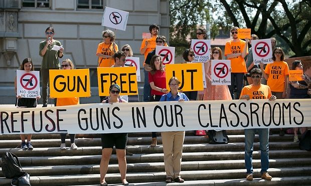 Protesters gathered on the West Mall of the University of Texas campus to oppose a new state law that expands the rights of concealed handgun license holders to carry their weapons on public college campuses next year.