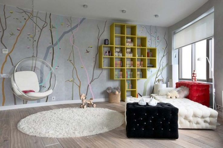 love love love that hanging chair! and the wall mural...and the green shelves...and the bed(?!) :)