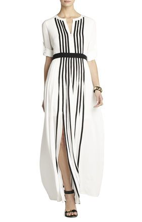 This dress has vertical lines, creating the illusion of being taller. The dress would look best on a rectangle body shape with a winter skin tone. This is because it is loose fitting and winter skin tones look best in black and white. The texture is linen, which is a tactile and visual texture.