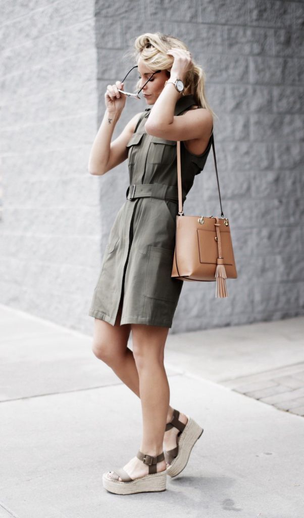 justthedesign:  There is nothing which screams military style more than a khaki shirt dress! This belted button up shirt dress just oozes edge and sophistication, and we love Mary Seng's choice to wear the look with a pair of espadrilles for added summer style. Dress: Nordstrom, Shoes: Marc Fisher, Bag: Henri Bendel.