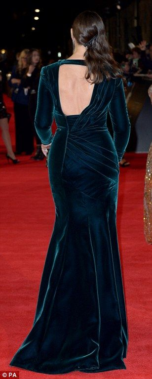Green with envy: Monica showed off her fabulous curves in a clinging green velvet backless...