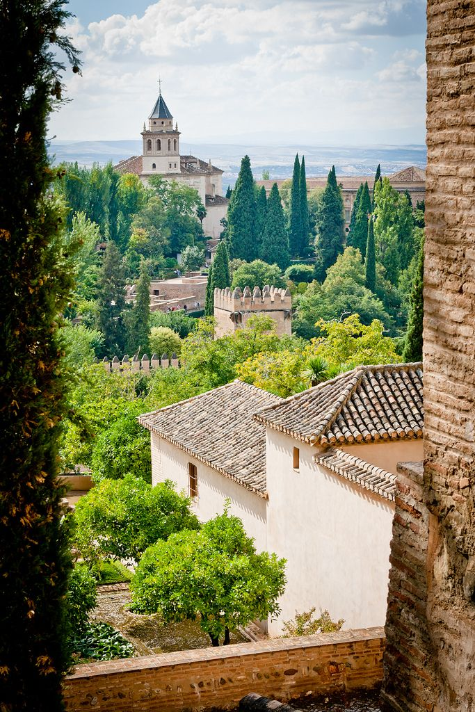 The Alhambra, Granada, Andalusia, Spain - It was originally constructed as a small fortress in 889 and then largely ignored until its ruins were renovated and rebuilt in the mid-13th century, when its current palace and walls were built. It was then converted into a royal palace in 1333. Moorish poets described it as 'a pearl set in emeralds' because of the colour of its buildings and the woods around them.