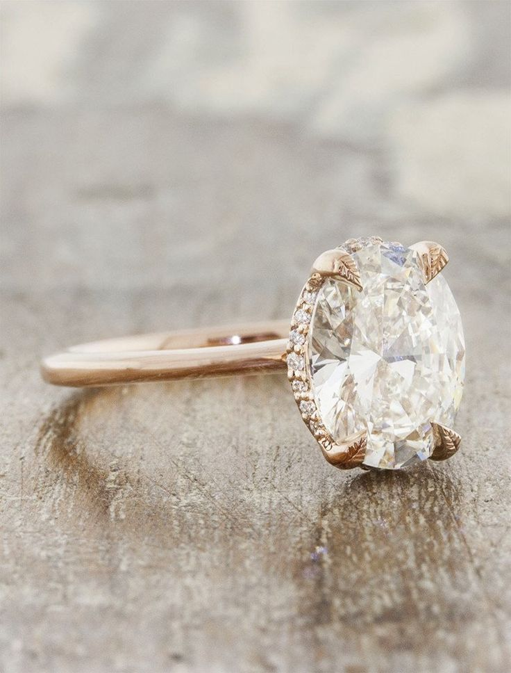 Isabella is a rose gold solitaire engagement ring by Ken + Dana Design.