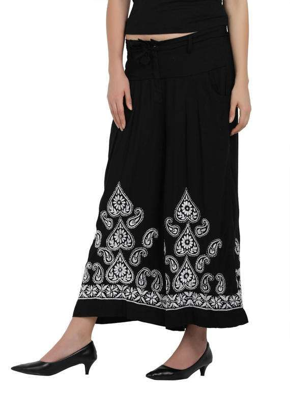 """Say hello to comfort and style, courtesy rayon fabric as you slip into these super chic and fashionable black embroidered palazzo's custom-made with easy front opening, button, zip and a belt to bring that extra knack to your look. Just club it with a long / knee length kurti and wedges and you are all set to charm the world around! A must pick for those women who love living fearlessly!       Suggested size chart     Waist Size : 20"""" to 36""""  Hip : 50""""   Length : 35""""  Material : Rayon  …"""