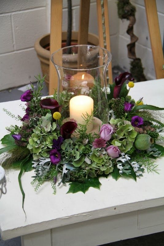 Pretty Centerpiece With A Candle And Purple Flowers