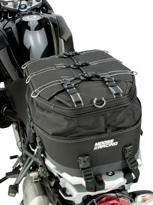 """Moose Racing Adventure Pillion Seat Pack •Developed to handle the rigors of adventure touring •Easy to install with quick-release, lockable buckles •Designed to offer a multitude of mounting configurations •Includes back pack strap so you can easily take your belongings with you •Rain cover included •Mates well with the rear seat and rear rack of most adventure motorcycles •20 lb. weight capacity •14"""" W x 20"""" L x 6"""" T (10 1/2"""" expanded)"""