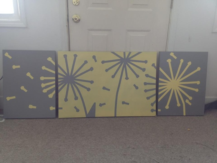 Paint your own wall art using masking tape circle stickers, canvas, and spray paint.