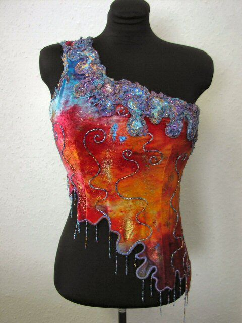 i love this piece of wearable art by Lesley George.  she is inspires by fantasy and nature Google Image Result for http://www.lesleygeorge.co.uk/media/organism.jpg