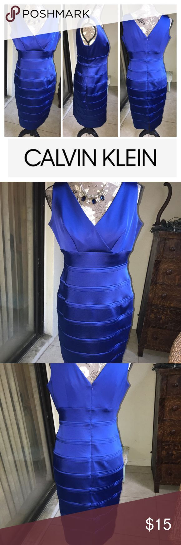 Vintage Calvin Klein Blue Satin Dress  Size 8. Stunning vintage 90's Calvin Klein royal blue sleeveless satin dress, size 8. There is no actual size tag, but previous owner states size 8. Cleavage has been professionally stitched together to avoid exposing too much. Has quite a few pulls in the satin, and priced accordingly. It's nothing detracting, but they are present, so I must disclose. Dry clean only. Necklace not included. From a smoke free, pet friendly home. Thank you! Calvin Klein…