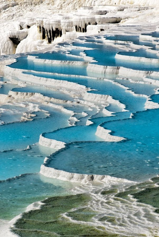 "Pamukkale, Turkey Pamukkale, meaning ""cotton castle"" in Turkish, is a natural site in Denizli Province in southwestern Turkey. The city contains hot springs and travertines, terraces of carbonate minerals left by the flowing water.  source: Wikipedia"
