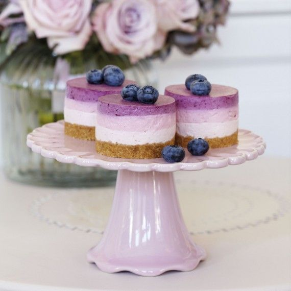 These stunning little cheesecakes are very easy to make and taste fabulous. They have a very light texture and consist of layers of strawberry, raspberry and blueberry.