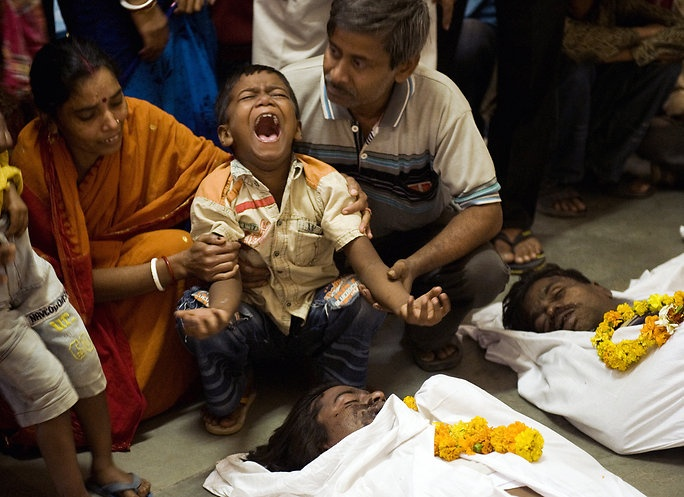 Manpreet Romana/Agence France-Presse: Families Collap, Delhi Building, Cremation Rite, Child Grieving, 67 Dead An, Delhi Late, Unidentified Indian, Child Cry, Indian Child