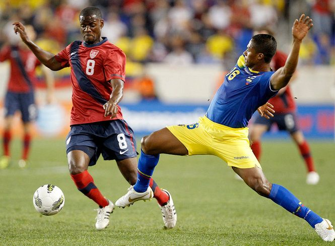 The USA's Maurice Edu, left, gets by Ecuador's Antonio Valencia in the 1st half. Ecuador won 1-0. U.S. Men Soccer team vs. Ecuador at Red Bulls stadium. Tuesday October 11, 2011. HARRISON, NJ, USA. Photo by (Aristide Economopoulos/The Star-Ledger)