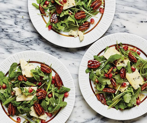 """Festive Arugula Salad  """"This salad is in constant rotation on our table because it's easy to prep and always a crowd-pleaser. Peppery arugula, crunchy pecans, juicy pomegranate seeds and nippy blue cheese are just a never-fail flavor explosion."""""""