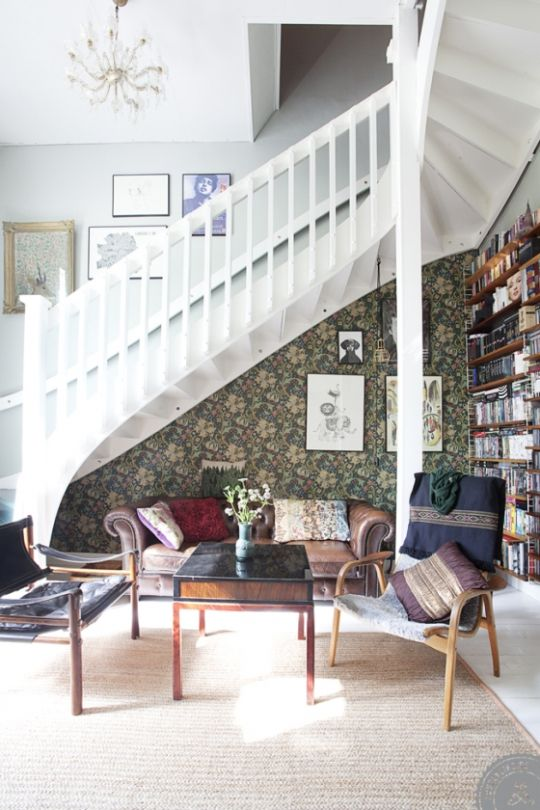 Architectural staircase with two different yet complimentary wall treatments. Plus a bookcase/library.