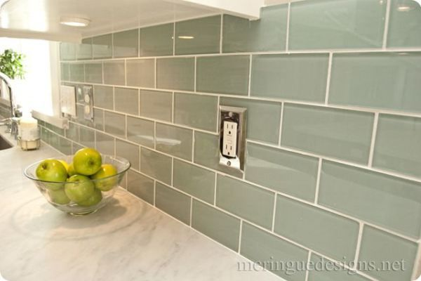 subway tile backsplash ideas for the kitchen. This glass subway tile in a seaglass green looks great with marble countertops