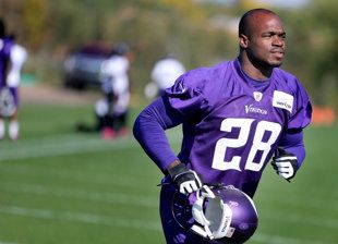 Adrian Peterson has faced a lifetime of personal tragedies, running hard through each one.  Adrian Peterson was at practice Friday for the Vikings. (AP)