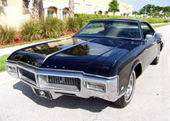 The earliest printed reference that I've found to the current meaning of the phrase 'bells and whistles' is in a classified advert for a 1969 Buick Riviera, in the Wisconsin newspaper The Capital Times, June 1971:      69 Riviera: One owner and driven very few miles, with all the bells and whistles, $3695.