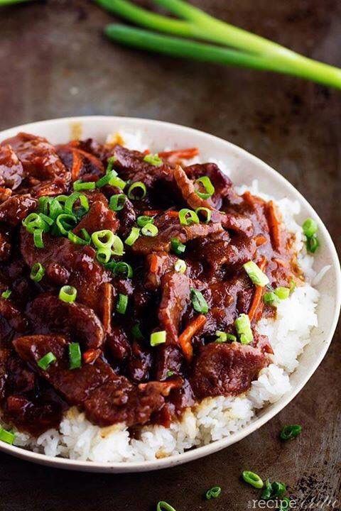 SLOW COOKER MONGOLIAN BEEF  1 kg Chuck Steak ¼ cups cornflour 2 tablespoons Olive Oil ½ tspn crushed Garlic Cloves ¾ cup Soy Sauce ¾ cup Water ¾ cup Brown Sugar 1 cup grated Carrots Shallots, for garnish. Cut steak into thin strips. In a ziplock bag add steak pieces and cornflour. Shake to coat. Add olive oil, minced garlic, soy sauce, water, brown sugar and carrots to slow cooker. Stir ingredients. Add coated steak and stir again until coated in the sauce. Cook for high 2-3 hours or on low…