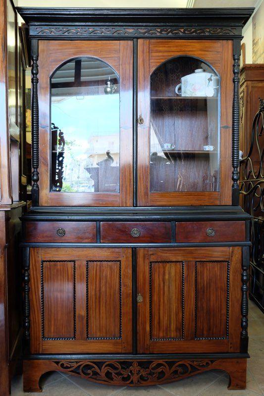 Credenza in noce e legno ebano, presenta intagli nella parte inferiore, composta da quattro ante. Periodo '800 restaurata.