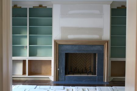 Soapstone surround, library lights and painted back bookcases - fab color