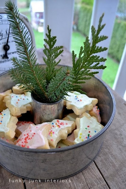 Use an old bundt pan to serve Christmas cookies. Place a small glass in the center to kept fresh greens. An easy grab and nibble.